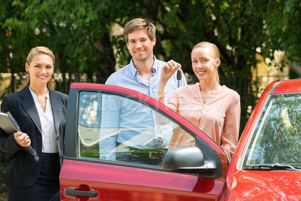Happy Young Couple With Key Of Newly Purchased Car Stock photo © AndreyPopov