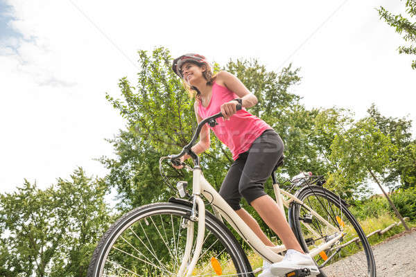 Happy Female Cyclist Riding Bicycle Stock photo © AndreyPopov