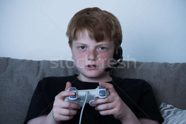 Boy With A Joystick Playing Videogames Stock photo © AndreyPopov