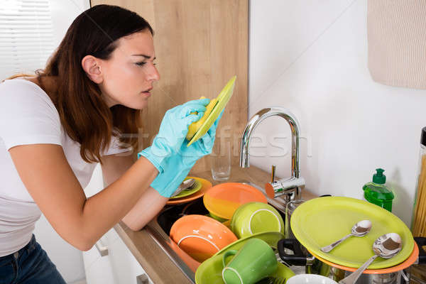 Woman Washing Plate Stock photo © AndreyPopov