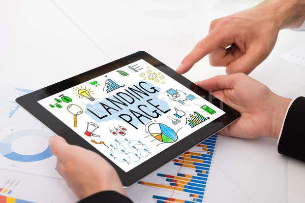 Bespreken landing pagina digitale tablet Stockfoto © AndreyPopov