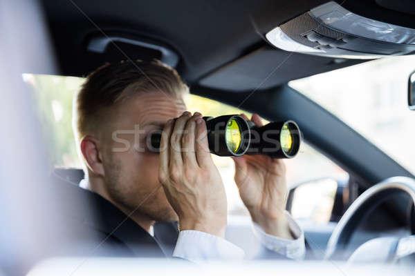 Man Looking Through Binocular Stock photo © AndreyPopov