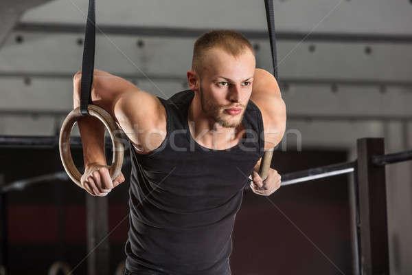 фитнес человека подготовки оружия гимнастики кольцами Сток-фото © AndreyPopov