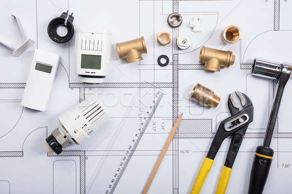Thermostat With Work Tools On Blueprints Stock photo © AndreyPopov