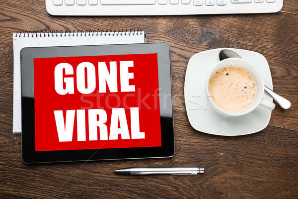 Stock photo: Coffee With Digital Tablet Displaying Gone Viral Text