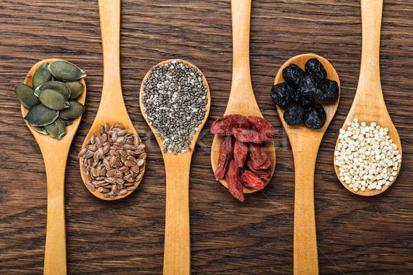 Superfoods In Wooden Spoons Stock photo © AndreyPopov