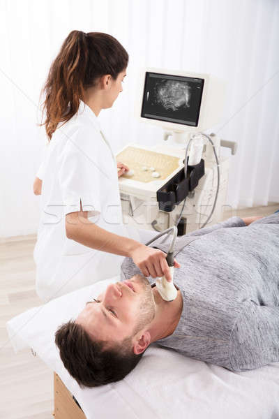 Man Getting Ultrasound Of A Thyroid From Doctor Stock photo © AndreyPopov