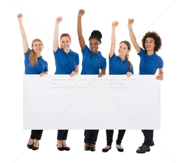 Group Of Female Janitors With Billboard Raising Their Arms Stock photo © AndreyPopov