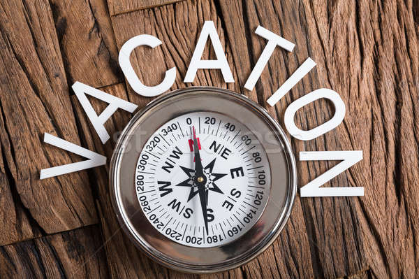 Compass With Vacation Text On Wood Stock photo © AndreyPopov