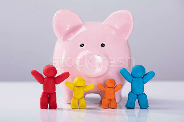 Colorful Clay Family In Front Of Piggybank Stock photo © AndreyPopov