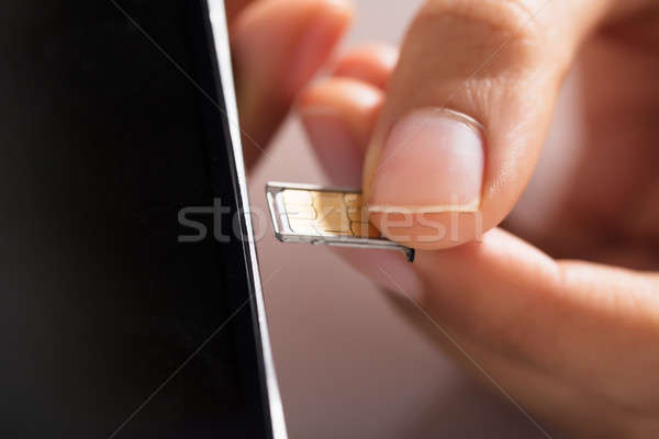 Persone mano micro primo piano cellulare telefono Foto d'archivio © AndreyPopov