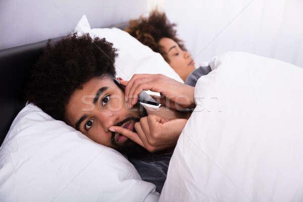 молодым человеком говорить сотового телефона жена спальный Сток-фото © AndreyPopov