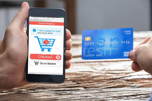 Empresario compras en línea tarjeta de débito mano Foto stock © AndreyPopov