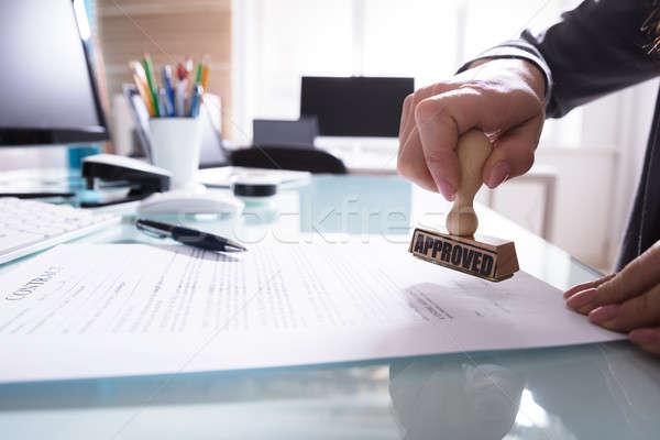 Businessperson Stamping Approved On Contract Paper Stock photo © AndreyPopov