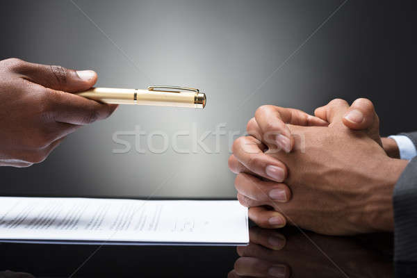 Person Offering Pen To The Other Person With Clasped Hand Stock photo © AndreyPopov