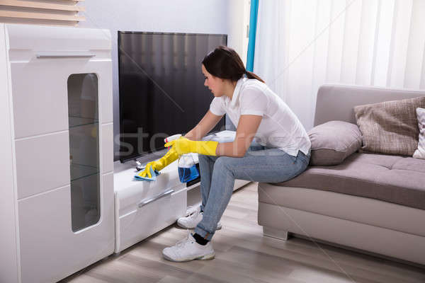 Female Janitor Cleaning Furniture Stock photo © AndreyPopov