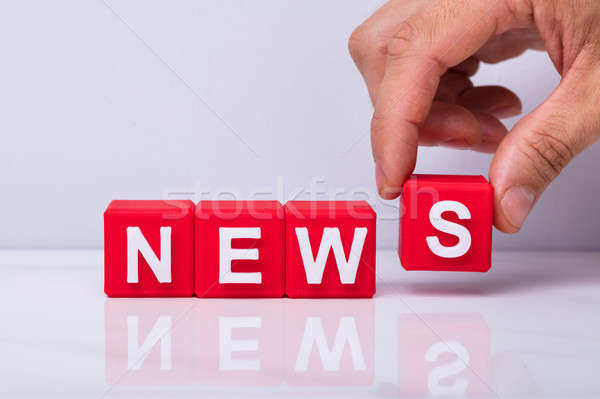 Person Making Word News With Cubic Blocks Stock photo © AndreyPopov