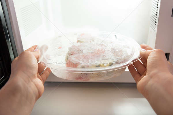 Woman Heating Food In Microwave Oven Stock photo © AndreyPopov