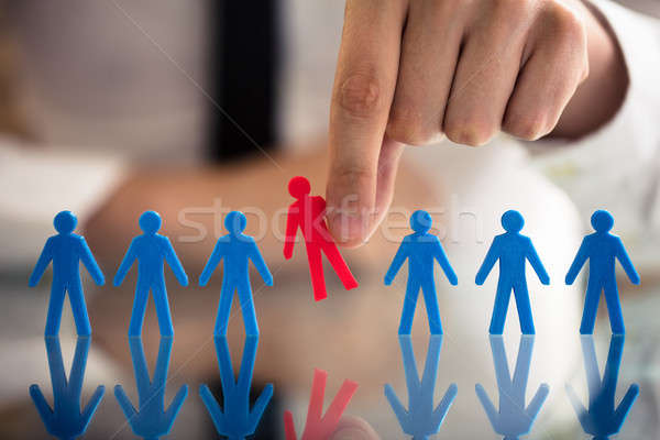 Businessperson Picking Red Human Figures Stock photo © AndreyPopov