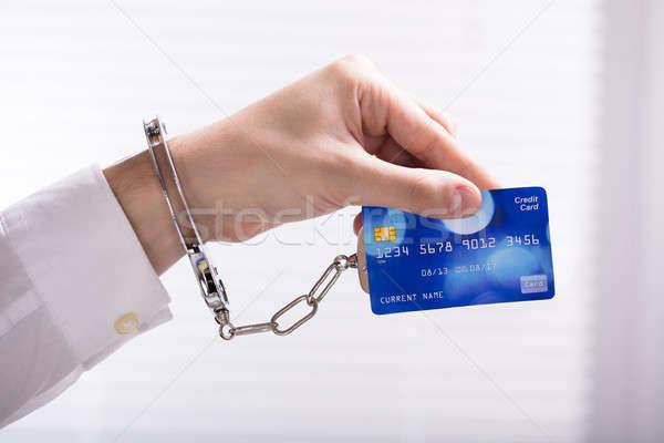 Arrestato persona mano carta di credito primo piano persone Foto d'archivio © AndreyPopov