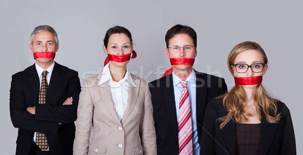 Businesspeople bound by red tape Stock photo © AndreyPopov