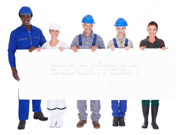 People With Diverse Professions Holding Placard Stock photo © AndreyPopov