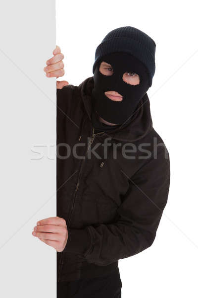 Bandit In Black Mask With Blank Card Stock photo © AndreyPopov