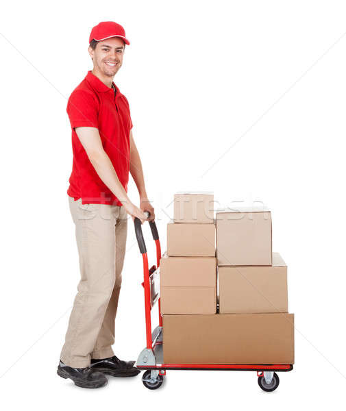 Deliveryman with a trolley of boxes Stock photo © AndreyPopov