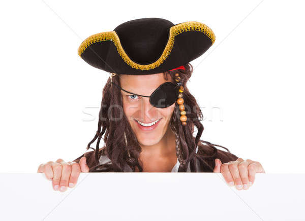 Young Pirate Pointing At Blank Placard Stock photo © AndreyPopov