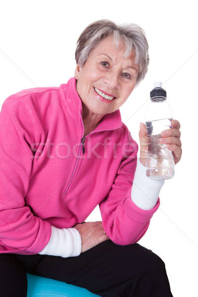 Senior Woman Holding Water Bottle Stock photo © AndreyPopov
