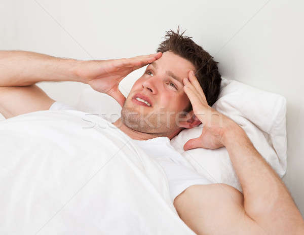 Stock photo: Man Suffering From Headache