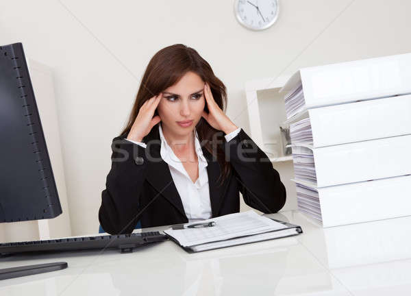 Overworked Businesswoman In Office Stock photo © AndreyPopov