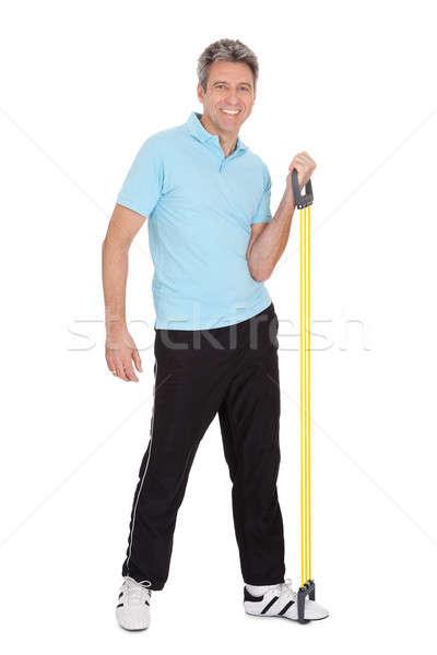Ativo homem maduro isolado branco fitness saúde Foto stock © AndreyPopov