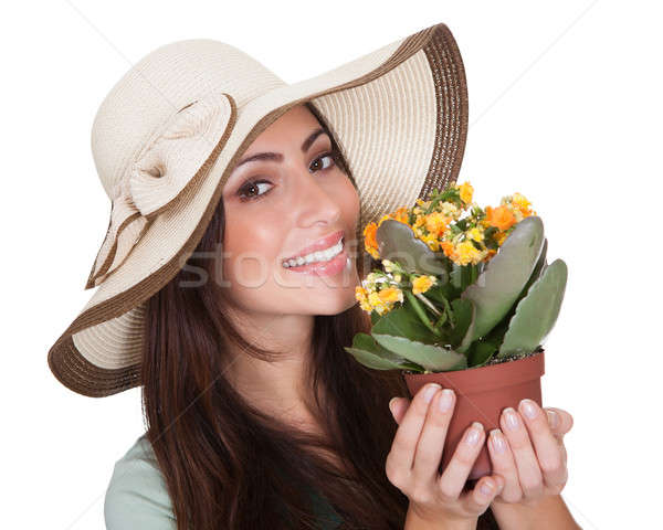 Pretty Woman Inhaling Fragrance Of Fresh Flower Stock photo © AndreyPopov