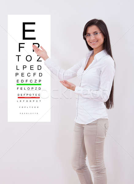 Woman pointing to an eye chart Stock photo © AndreyPopov