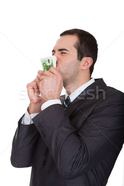 Excited businessman kissing euro notes Stock photo © AndreyPopov