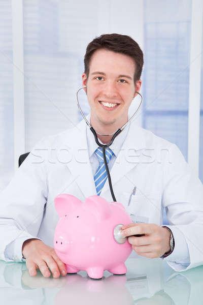 Doctor Examining Piggybank With Stethoscope In Hospital Stock photo © AndreyPopov
