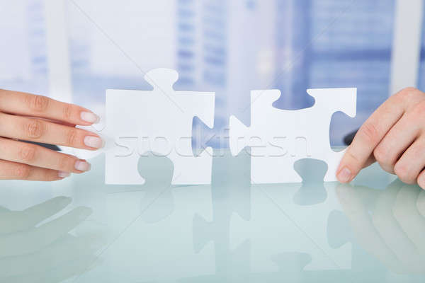 Business People Joining Jigsaw Pieces In Office Stock photo © AndreyPopov