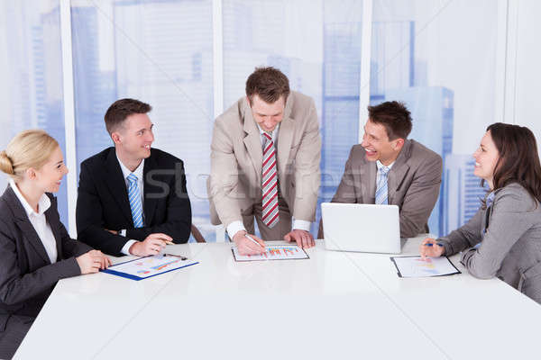 Business People Discussing Graph At Conference Table Stock photo © AndreyPopov