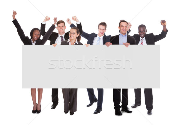 Successful Businesspeople Holding Blank Billboard Stock photo © AndreyPopov