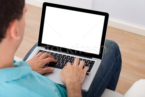 Man Using Laptop At Home Stock photo © AndreyPopov