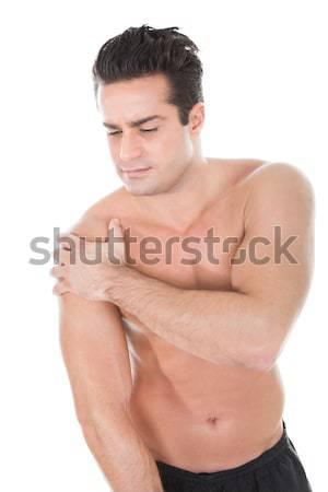 Jonge man lijden schouderpijn gespierd medische Stockfoto © AndreyPopov