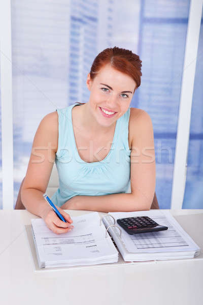 Woman Calculating Home Finances At Desk Stock photo © AndreyPopov