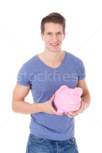 Stockfoto: Jonge · man · spaarpot · portret · gelukkig · witte
