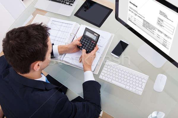 Businessman Calculating Tax Stock photo © AndreyPopov