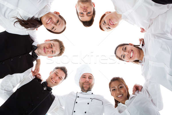 Waiters and waitresses standing in circle Stock photo © AndreyPopov