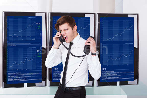Angry Stock Broker Talking On Telephone Stock photo © AndreyPopov
