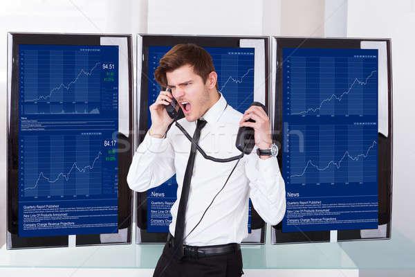 öfkeli stok komisyoncu konuşma telefon Stok fotoğraf © AndreyPopov