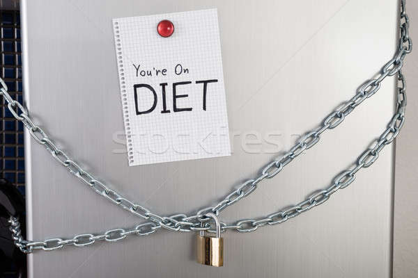 Note With Diet Text On Locked Fridge Stock photo © AndreyPopov