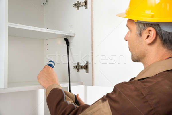 Pest Control Worker Wearing Hardhat Spraying Pesticides Stock photo © AndreyPopov